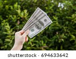 hands holding pocket money with ... | Shutterstock . vector #694633642