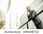 handsome young businessman... | Shutterstock . vector #694648762