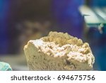 Small photo of Microcline rock specimen from mining and quarrying industries. Microcline (KAlSi3O8) is an important igneous rock-forming tectosilicate mineral. It is a potassium-rich alkali feldspar.