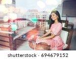 beautiful indian woman through... | Shutterstock . vector #694679152