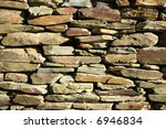 Old stone wall close up. - stock photo