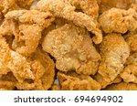 crispy fried chicken skins | Shutterstock . vector #694694902