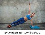 woman doing plank exercise... | Shutterstock . vector #694695472
