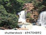 waterfall in zongo. democratic... | Shutterstock . vector #694704892
