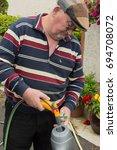 senior old age pensioner male... | Shutterstock . vector #694708072