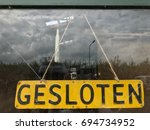 Small photo of Sign with text in dutch, text means closed