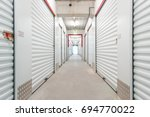hallway with white storage... | Shutterstock . vector #694770022