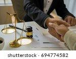consultation between a business ...   Shutterstock . vector #694774582