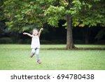 little girl practicing jump rope | Shutterstock . vector #694780438