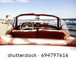retro car on beach and two... | Shutterstock . vector #694797616