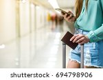 woman wait for the flight  time ... | Shutterstock . vector #694798906