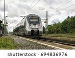 "Small photo of Lauchhammer, Brandenburg, Germany - 20 May 2017: A regional train / suburban train (""S-Bahn"") S4 to Hoyerswerda of the S-Bahn Mitteldeutschland (""DB Regio Südost"") arrives Lauchhammer in the morning."