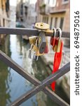 Small photo of Love locks affixed to a fence at a bridge near to Canale Grande, Venice