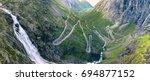 trollstigen famous serpentine... | Shutterstock . vector #694877152