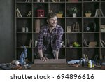 happy at work. young man... | Shutterstock . vector #694896616