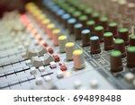 mixer in radio broadcast room | Shutterstock . vector #694898488