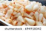 Small photo of Pickled Leeks (pickled scallion heads) - Popular Vietnamese food on Tet holidays made from Chinese scallion (Allium chinense - edible species of onions) - Vietnam Food. Dua kieu tet vietnam.