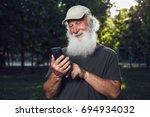 emotional senior man talking on ...   Shutterstock . vector #694934032