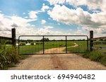 metal gate closed on a dirt...   Shutterstock . vector #694940482