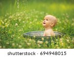 cute baby swims in the bath on... | Shutterstock . vector #694948015
