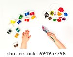 top view child's hands draws a... | Shutterstock . vector #694957798