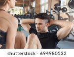 young couple exercise together... | Shutterstock . vector #694980532