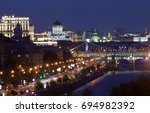 Small photo of Night panorama of the Moscow (Russia) with historical buildings, alighted streets, streetlights, bridges over the Moskva river and dark blue sky