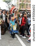 Small photo of COTACACHI, ECUADOR - JUNE 29, 2017: Man in an American Indian costume in the men's parade in Inti Raymi, the indigenous seed festival, with a history of violence in the village