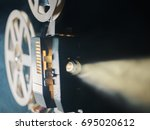 film projector on a black...   Shutterstock . vector #695020612