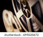 film projector on a black... | Shutterstock . vector #695020672