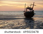 sunset with fishing boat | Shutterstock . vector #695023678