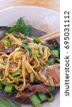 Small photo of Egg noodle in thicken soup topping with slice pork, Pork liver and morning glory