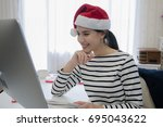 beautiful women wearing a santa ... | Shutterstock . vector #695043622