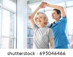 physiotherapist working with...   Shutterstock . vector #695046466