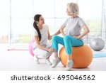 physiotherapist working with... | Shutterstock . vector #695046562