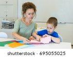 teacher woman and child boy... | Shutterstock . vector #695055025
