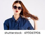 Woman In Glasses Holds A Hair...