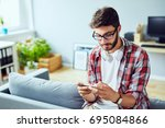 young man leaning on sofa and... | Shutterstock . vector #695084866