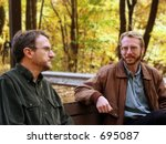 Conversation on a park bench - stock photo