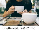close up of a girl in a cafe... | Shutterstock . vector #695093182