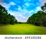 beautiful golf course on blue... | Shutterstock . vector #695100286