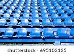 plastic seats in the stadium | Shutterstock . vector #695102125