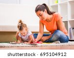 mother and daughter in their... | Shutterstock . vector #695104912
