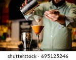 close up barmans hands with... | Shutterstock . vector #695125246