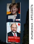Small photo of AUGUST 12, 2017 - BERLIN: election posters of the German Chancellor Angela Merkel (CDU) and her challenger, Martin Schulz (SPD), in the upcoming elections, Berlin.