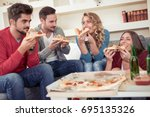 group of young friends eating... | Shutterstock . vector #695135326