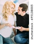 pregnant girl with her husband... | Shutterstock . vector #695138005