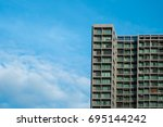 high rise condominium with blue ... | Shutterstock . vector #695144242