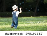 happy little girl playing with... | Shutterstock . vector #695191852
