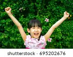 happy child with both hands in... | Shutterstock . vector #695202676
